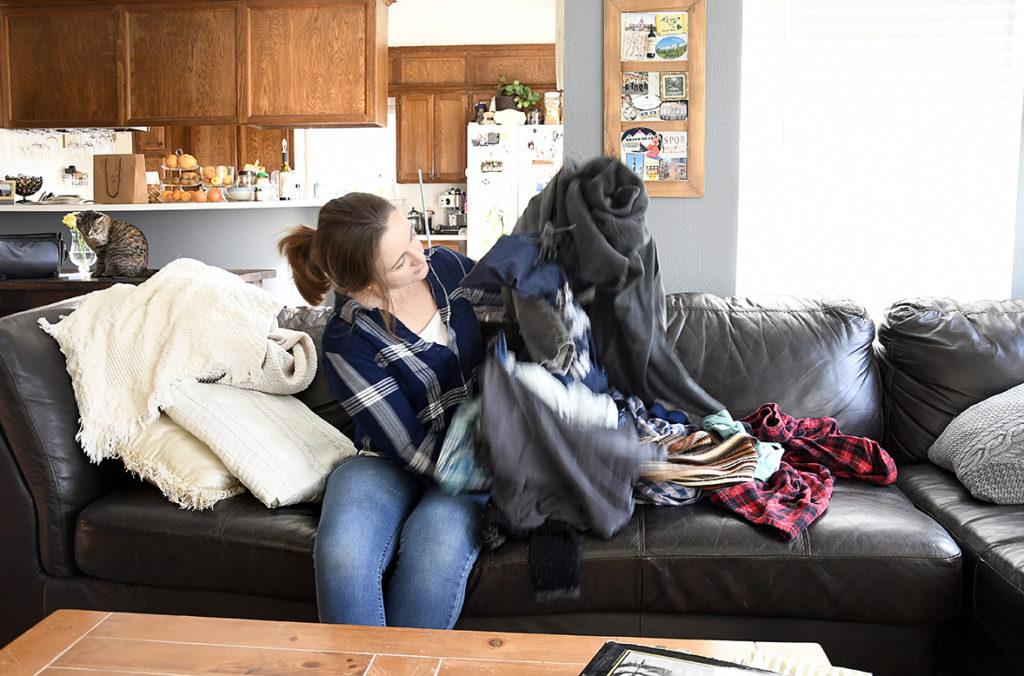 Hannah folds laundry