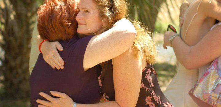 Women Hugging - Warm Welcome